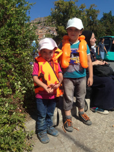 "Syrian children still in their ""life jackets"" waiting for the bus. Taken by Peggy Whitfield in Lesvos"
